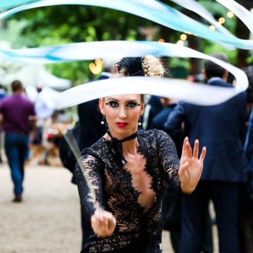 Mix and mingle, entertainment, juggler, theming, events, London, garden, grass, party, Summer, sunshine, tong, twirl, ribbon